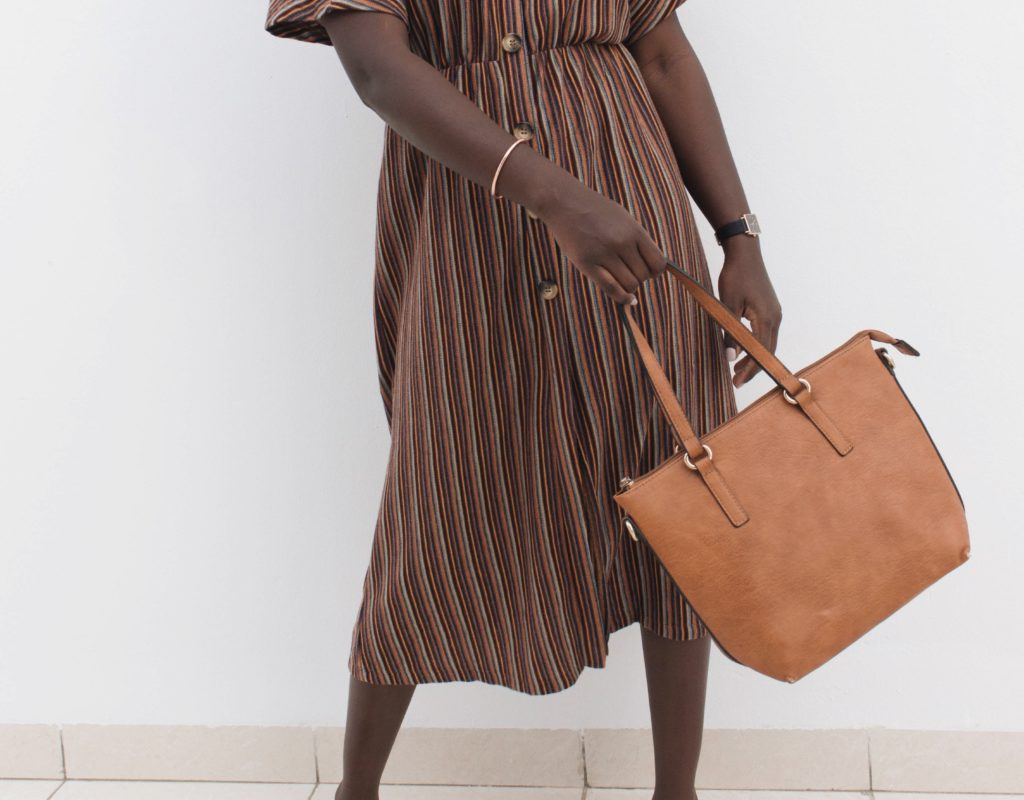 earth tones stripped dress with camel handbag and shoes